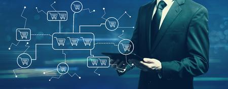 Foto de Online shopping theme with businessman holding a tablet computer - Imagen libre de derechos