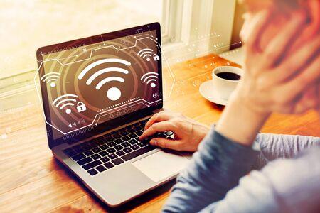 Photo pour Wifi with man using a laptop computer - image libre de droit