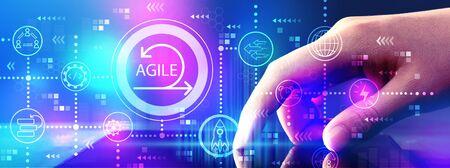Foto de Agile concept with hand pressing tablet computer screen - Imagen libre de derechos