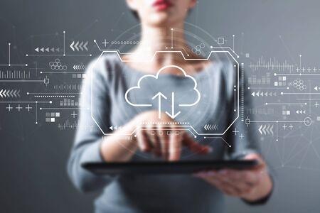 Foto de Cloud computing with business woman using a tablet computer - Imagen libre de derechos