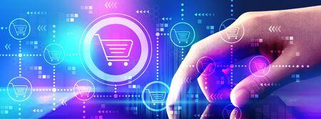 Foto de Online shopping theme with hand pressing tablet computer screen - Imagen libre de derechos