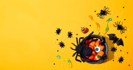 Foto de Halloween decorations with witch cauldron - overhead view flat lay - Imagen libre de derechos