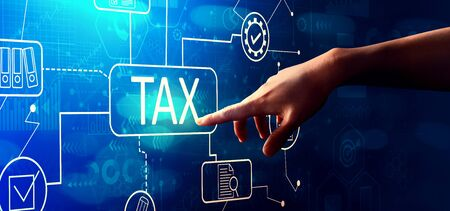 Foto de Tax theme with hand pressing a button on a technology screen - Imagen libre de derechos