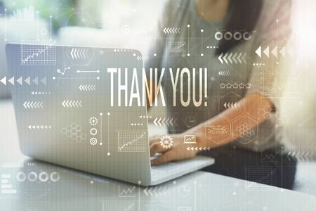 Photo for Thank you with woman using her laptop in her home office - Royalty Free Image