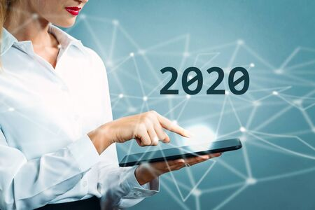Photo for 2020 text with business woman using a tablet - Royalty Free Image