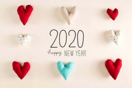 Photo pour Happy New Year 2020 message with blue heart cushions on a white paper background - image libre de droit