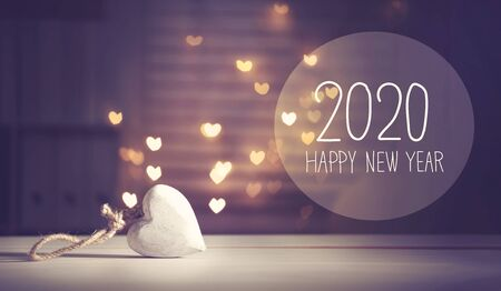 Photo pour New Year 2020 message with a white heart with heart shaped lights - image libre de droit