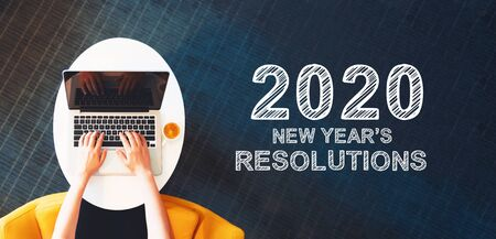 Photo pour 2020 New Years Resolutions with person using a laptop on a white table - image libre de droit