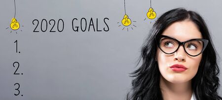 Photo for 2020 goals with young businesswoman in a thoughtful face - Royalty Free Image
