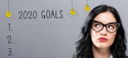 Foto de 2020 goals with young businesswoman in a thoughtful face - Imagen libre de derechos