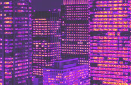 Foto de Skyscrapers illuminated at night in Tokyo, Japan synth wave style - Imagen libre de derechos