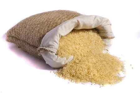 View of a sack of yellow rice isolated on a white background.