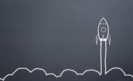 Photo pour chalk drawing rocket on blackboard Going up quickly - image libre de droit