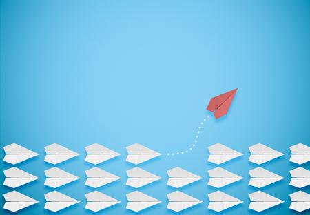 Foto de different thinking concept.red paper plane leaving the group - Imagen libre de derechos