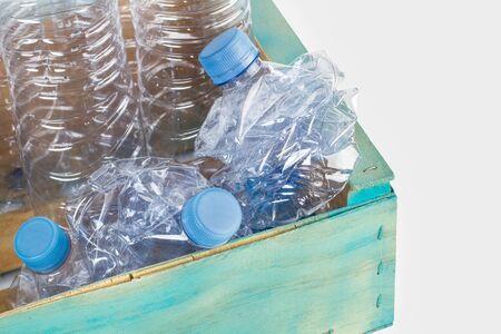 Foto de Empty plastic bottles in a blue wooden box - Imagen libre de derechos