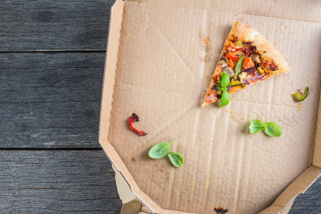 leftovers slices of homemade vegetarian pizza in box from above