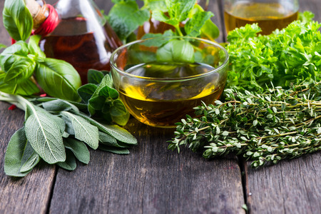 Photo pour Fresh herbs from garden with olive oil, seasoning background - image libre de droit