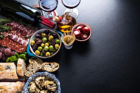 Foto de spanish tapas, food border background overhead view - Imagen libre de derechos