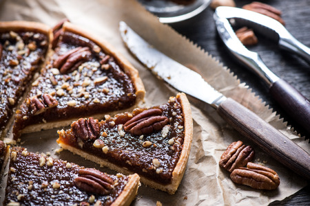 Photo for slicing pecan pie on wooden table, overhead view - Royalty Free Image