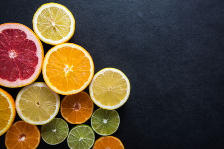 Photo for Fresh citrus fruits half cut, dark border background with copy space,from above - Royalty Free Image