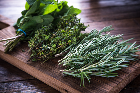 Photo pour bunch of garden fresh herbs on wooden board from above - image libre de droit
