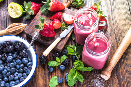 Photo for Preparation of antioxidant and refreshing smoothie, well being and weight loos concept. On wooden table from above. - Royalty Free Image