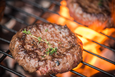 Photo for close up burger on bbq over flames - Royalty Free Image