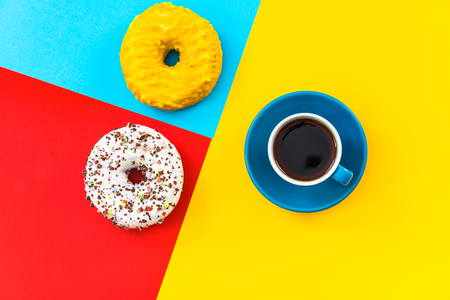 Photo for Coffee cup and donut minimalistic colorful design, flat lay and top view - Royalty Free Image