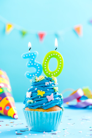 Photo pour Thirtieth 30th birthday cupcake with candle and sprinkles. Card mockup. - image libre de droit