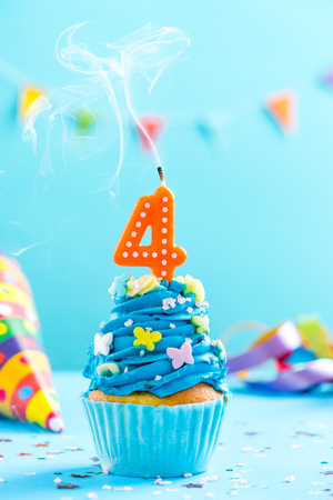 Photo pour Fourth 4th birthday cupcake with candle blow up and sprinkles. Card mockup. - image libre de droit
