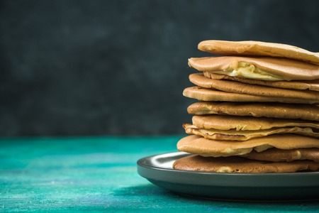 Photo for Homemade pancakes stack in pile on plate, copy space - Royalty Free Image