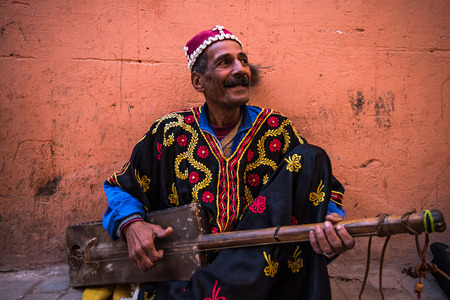 Photo for Marrakech,Morocco - January 2018:TStreet musician in traditional clothing performing on street - Royalty Free Image