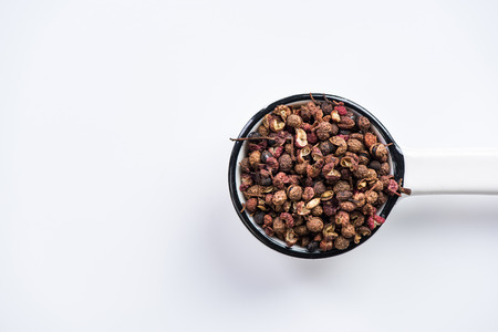 Photo for Sichuan pepper or Chinese coriander on spoon. - Royalty Free Image