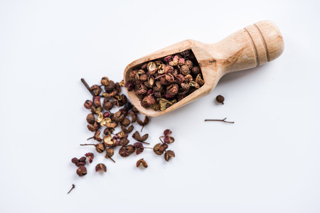 Photo for Wooden spoon with Chinese coriander,Sichuan pepper. - Royalty Free Image