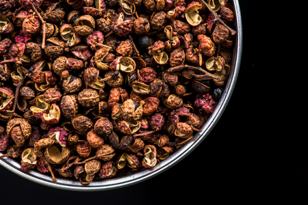 Photo for Sichuan pepper on pot on dark background with copy space. - Royalty Free Image