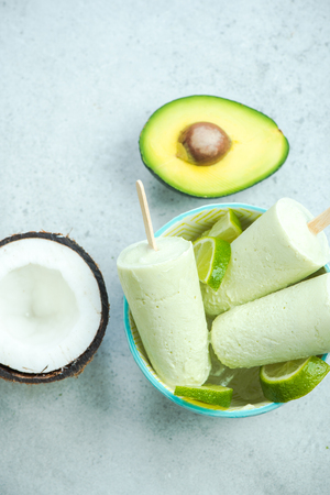 Photo for Avocado,lime and coconut healthy trendy ice lolly - Royalty Free Image