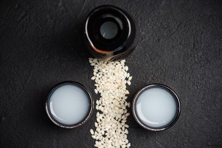 Foto de Japanese sake vodka and rice,copy space. - Imagen libre de derechos