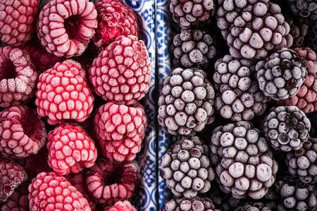 Photo for Frozen blackberry and raspberry fruits, close up. - Royalty Free Image