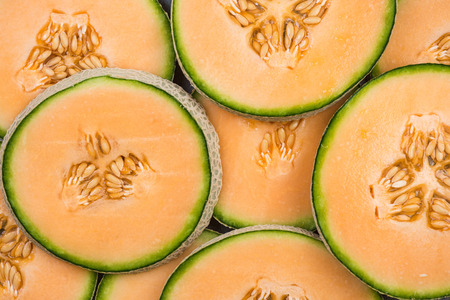 Photo pour Cantaloupe melon slices, full frame food background. - image libre de droit