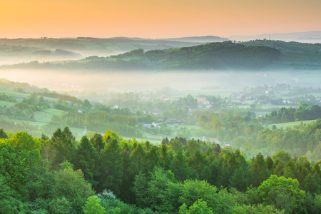 Photo for Early spring mist over countryside hills at sunrise. - Royalty Free Image