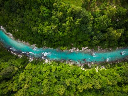 Photo pour River Soca cutting trough forest, Slovenia. Drone photo. - image libre de droit