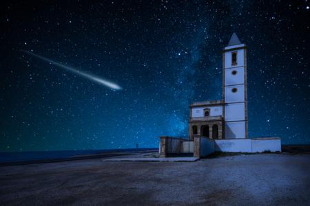 Photo pour Perseid Meteor Shower and the Milky Way over castle over church La Almadraba de Monteleva,Spain - image libre de droit