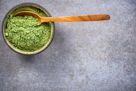 Photo for Traditional bowl with green Matcha tea powder. Top view, copy space. - Royalty Free Image
