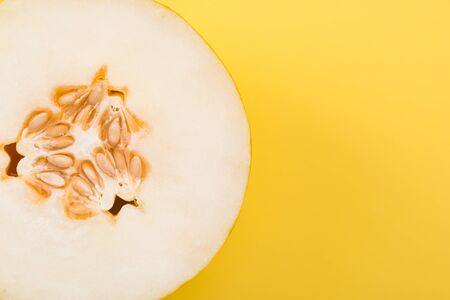 Photo for Yellow Musk Melon Sliced in Half on Pastel Background, Top View. - Royalty Free Image