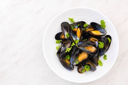 Photo pour Freshly Catch Mussels Served on Plate,Seafood Restaurant Dish. - image libre de droit