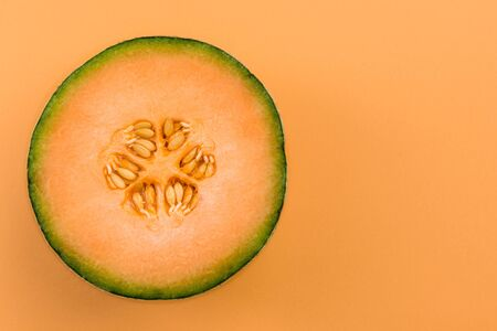 Photo for Cantaloupe Orange Melon Sliced in Half on Pastel Background. - Royalty Free Image