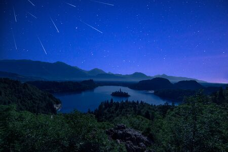 Photo pour Perseid MEteor Shower over Bled Lake at Starry Dark Night in Summer. - image libre de droit