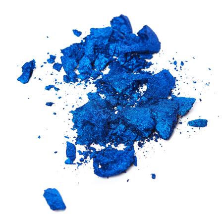 Crushed blue eye shadow isolated on white background