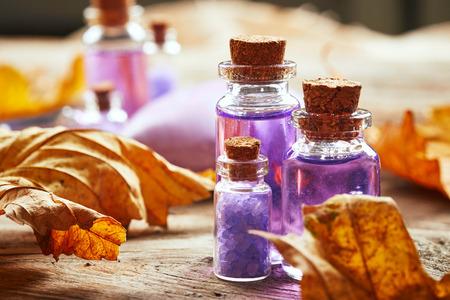 Photo pour Purple Spa still life with autumn leaves on wooden background - image libre de droit