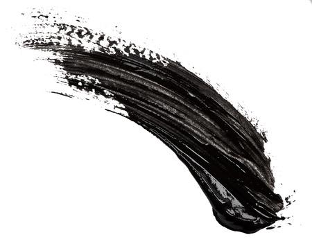 Foto de Black paint isolated on white background - Imagen libre de derechos